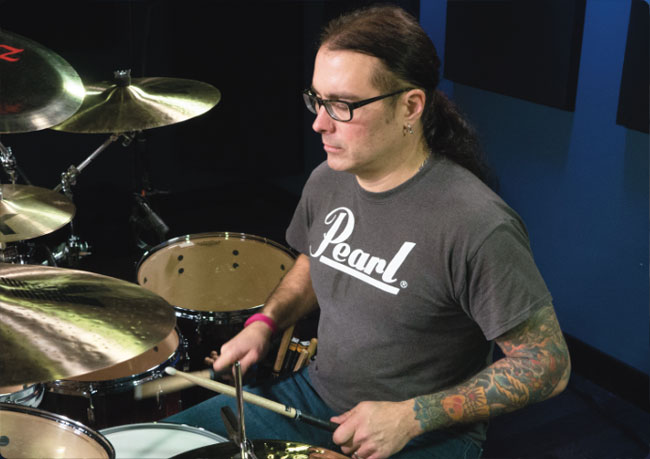 JASON BITTNER, an instructor for Drumeo.