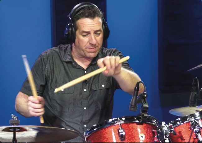 JIM RILEY, an instructor for Drumeo.