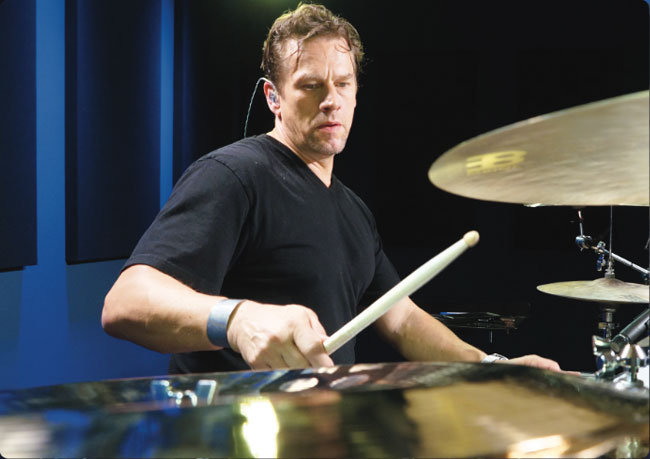 THOMAS LANG, an instructor for Drumeo.